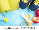yoga mat  sport shoes  apples ... | Shutterstock . vector #572573041