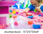 boy playing with kinetic sand... | Shutterstock . vector #572573569