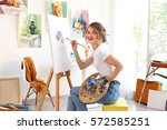young female artist painting... | Shutterstock . vector #572585251