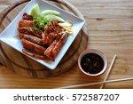 peking duck on cutting board   Shutterstock . vector #572587207