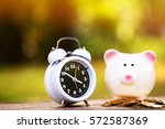 close up piggy bank and alarm... | Shutterstock . vector #572587369