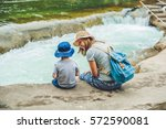 mom and young son sitting on... | Shutterstock . vector #572590081