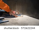 gloved hand of a construction... | Shutterstock . vector #572622244