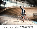 young man on a velodrome | Shutterstock . vector #572649499