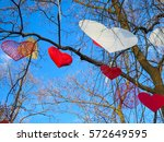 many decorative hearts hanging... | Shutterstock . vector #572649595