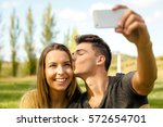 young beautiful couple making a ... | Shutterstock . vector #572654701