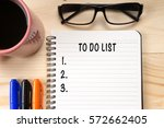 to do list text on notebook... | Shutterstock . vector #572662405