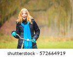 happy active woman with bike... | Shutterstock . vector #572664919