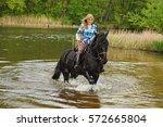 pretty girl riding horse in...   Shutterstock . vector #572665804