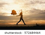 Silhouette Of Happy Woman...