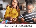 smiling african american female ... | Shutterstock . vector #572690524