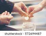 hands of couple lover saving... | Shutterstock . vector #572694487