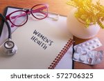 stethoscope on note book with... | Shutterstock . vector #572706325