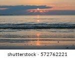 beautiful sunset at seaside.... | Shutterstock . vector #572762221