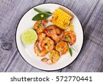 grilled shrimps and corn... | Shutterstock . vector #572770441