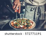 chef cooking a gourmet tasty... | Shutterstock . vector #572771191