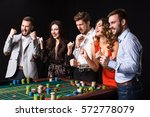 group of young people behind... | Shutterstock . vector #572778079