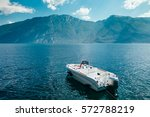 motor boat on beautiful garda... | Shutterstock . vector #572788219