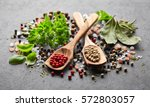 spices and herbs on a black... | Shutterstock . vector #572803057