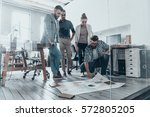 discussing strategy. group of... | Shutterstock . vector #572805205