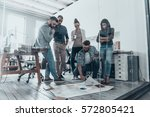 discussing strategy. handsome... | Shutterstock . vector #572805421