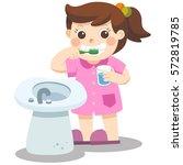 a little girl happy to brush... | Shutterstock .eps vector #572819785