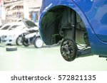car with removed wheel | Shutterstock . vector #572821135
