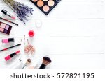 makeup set on white table with... | Shutterstock . vector #572821195