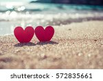 romantic symbol of two hearts... | Shutterstock . vector #572835661