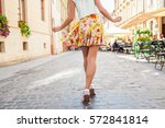 young stylish woman walking the ... | Shutterstock . vector #572841814