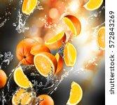 orange fruits and splashing... | Shutterstock . vector #572843269
