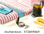 striped dress with tea in the... | Shutterstock . vector #572849869