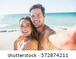 couple taking a selfie on the... | Shutterstock . vector #572874211