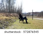 man resting on a bench in the... | Shutterstock . vector #572876545