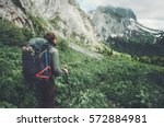Small photo of Man traveler with backpack hiking Travel Lifestyle concept adventure active summer vacations outdoor rocky mountains on background