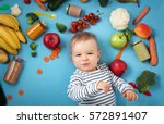 baby surrounded with fruits and ... | Shutterstock . vector #572891407