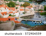 small houses with red roofs in... | Shutterstock . vector #572904559