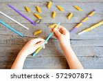 small kid holds straw and dried ... | Shutterstock . vector #572907871