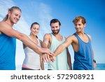 friends putting their hands...   Shutterstock . vector #572908921