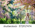 beautiful young woman enjoying...   Shutterstock . vector #572917474