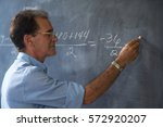 people and education. teacher... | Shutterstock . vector #572920207