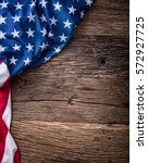 Small photo of USA flag. American flag. American flag freely lying on wooden board. Close-up Studio shot. Toned Photo.