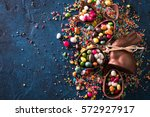 Stock photo delicious chocolate easter eggs bunny and sweets on dark blue background 572927917