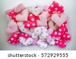 a lot of handmade fabric hearts ... | Shutterstock . vector #572929555