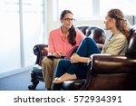 psychologist having session... | Shutterstock . vector #572934391