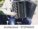 Musician With Accordion Playin...