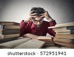 student with glasses studies... | Shutterstock . vector #572951941