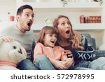 family watching scary movie at... | Shutterstock . vector #572978995