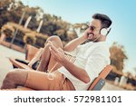 young handsome man with... | Shutterstock . vector #572981101