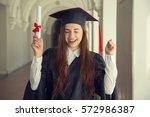 very happy woman on her...   Shutterstock . vector #572986387